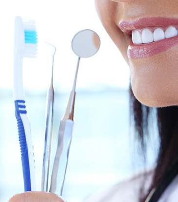 Checkup and cleaning by Dental Hygienists at Arvada Dental Center co